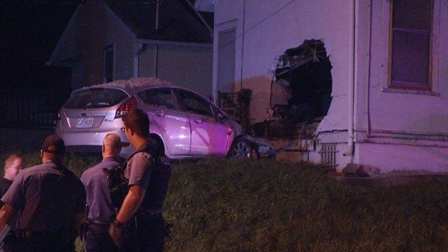Police say a car went airborne and slammed into the church, leaving a large hole in the wall. (KCTV5)