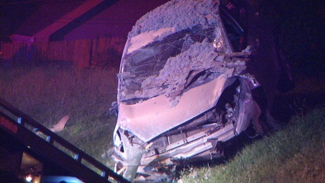 Officers say a crash made that car take flight and hit the side of the church. (KCTV5)