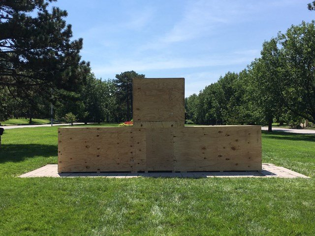 The monument had been protected by plywood after it was vandalized. The wood was removed about 5 a.m. on Friday. (KCTV5)