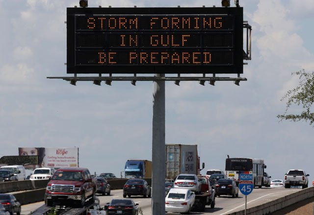 Motorists in Houston pass a sign warning of Hurricane Harvey as the storm intensifies in the Gulf of Mexico, Thursday, Aug. 24, 2017. Harvey is forecast to be a major hurricane when it makes landfall along the middle Texas coastline Friday. (AP)