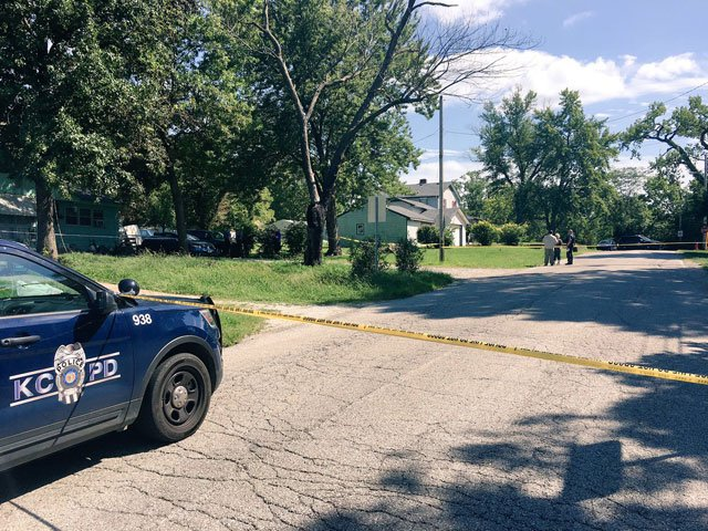 The shooting happened just after 2 p.m. in the 5700 block of Cambridge.A suspect was taken into custody at the scene. (Rudy Harper/KCTV5 News)