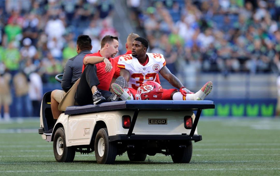 Kansas City Chiefs running back Spencer Ware is taken off the field on a cart after an injury during the first half of an NFL football preseason game against the Seattle Seahawks, Friday, Aug. 25, 2017, in Seattle. (AP Photo/John Froschauer)