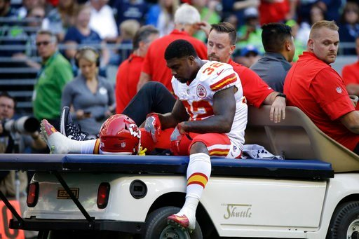 Kansas City Chiefs Spencer Ware leaves the field on a cart after being injured against the Seattle Seahawks in the first half of an NFL football preseason game, Friday, Aug. 25, 2017, in Seattle. (AP Photo/Elaine Thompson)
