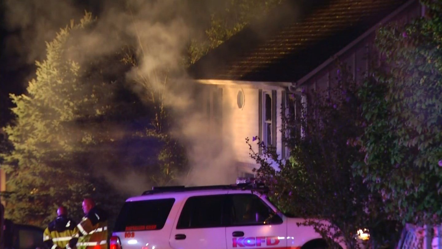 A neighbor says the fire started in the basement or lower level of the home and described the flames as a fireball. (KCTV5)