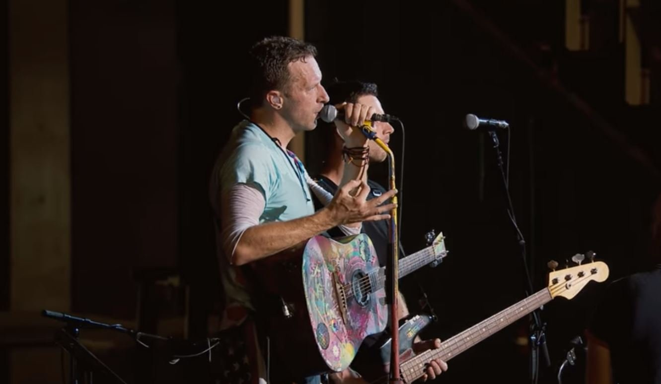 """This is because we all grew up loving country music, and of course that's kind of what we think of when we go to Texas,"" frontman Chris Martin told the crowd at Miami's Hard Rock Stadium. (Coldplay Official/YouTube)"