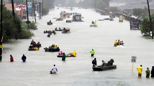 (AP Photo/David J. Phillip). Rescue boats fill a flooded street as flood victims are evacuated as floodwaters from Tropical Storm Harvey rise Monday, Aug. 28, 2017, in Houston.