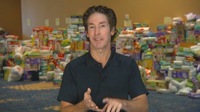 Joel Osteen is defending the decision not to open his Houston megachurch as a shelter during the initial flooding from Harvey in the face of withering criticism on social media. (CBS)