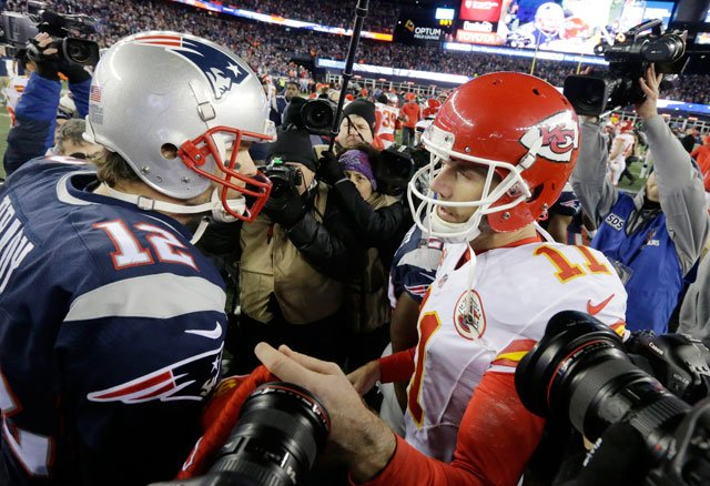 New England Patriots quarterback Tom Brady (12) and Kansas City Chiefs quarterback Alex Smith (11) meet at midfield after an NFL divisional playoff football game, Saturday, Jan. 16, 2016, in Foxborough, Mass. The Patriots won 27-20. (AP)