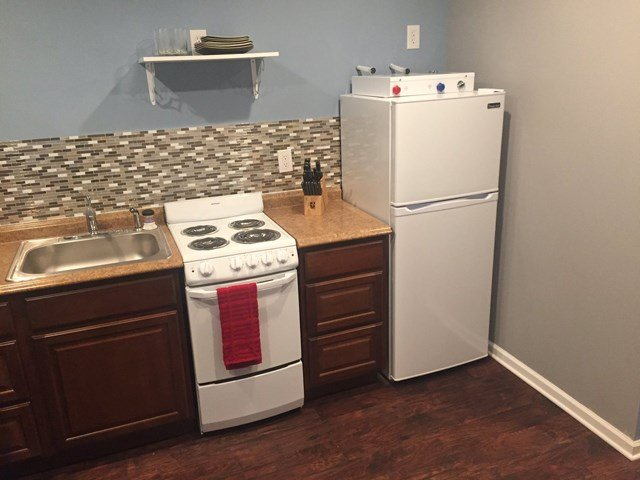The 240-square-foot tiny homes come fully equipped with a full kitchen, bedroom and bathroom. (KCTV5)