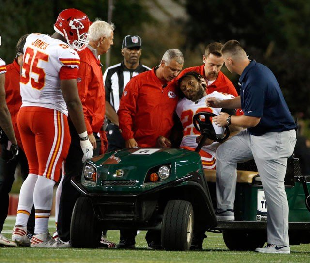 Teammates console Kansas City Chiefs safety Eric Berry (29) after he was put on a cart following an injury during the second half of an NFL football game against the New England Patriots. (AP)