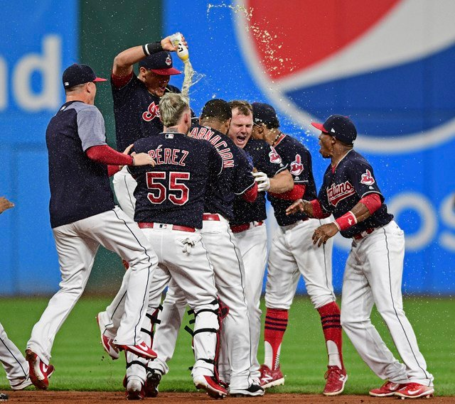 After blowouts, shutouts and oh-so-easy wins, the Indians went into extras for the first time to keep the longest streak in 101 years intact. (AP)