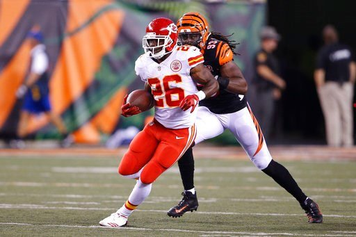 Kansas City Chiefs running back C.J. Spiller (26) runs the ball with Cincinnati Bengals defensive end Will Clarke (93) in pursuit in the second half of an NFL preseason football game, Saturday, Aug. 19, 2017, in Cincinnati. (AP Photo/Gary Landers)