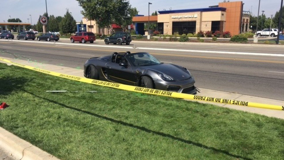 Preliminary information shows that a driver of a gray Porsche was accelerating rapidly as he left the car show parking lot going onto East Overland Road. The vehicle lost control and crashed into several pedestrians on the sidewalk. (KBOI Staff Photo)