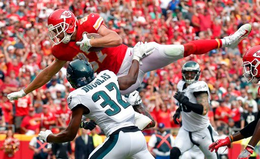 Kansas City Chiefs tight end Travis Kelce (87) leaps over Philadelphia Eagles cornerback Rasul Douglas (32) for a touchdown during the second half of an NFL football game in Kansas City, Mo., Sunday, Sept. 17, 2017. (AP Photo/Ed Zurga)