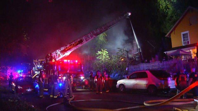 Firefighters battled flames and heavy smoke coming from the home. (KCTV5)
