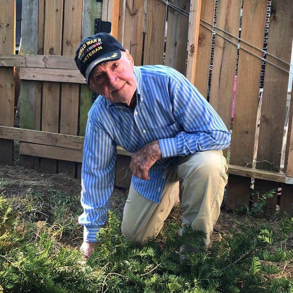 Brennan Gilmore posted a Twitter picture Sunday morning of his grandfather, John Middlemas, kneeling while wearing a veteran's cap. (Brennan Gilmore/Twitter)