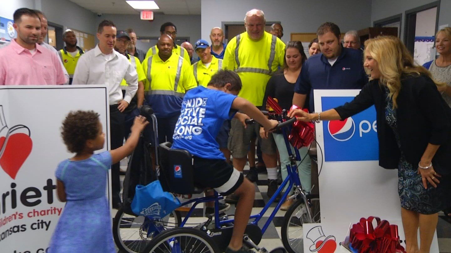 Olathe Pepsi employees raised almost $3,000 on their own to purchase an adaptive bike custom fit for Damien. It's an expense not covered by insurance. (KCTV5)