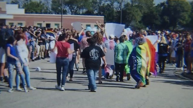 """Parents say a group of students had things thrown at them as people chanted """"Make Olathe Northwest straight again"""" at the school's homecoming parade. (KCTV5)"""