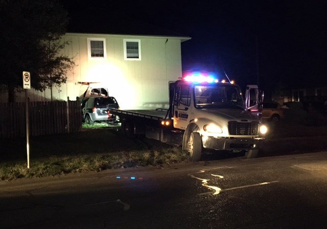 Police say people were inside the house when the vehicle struck its left side. (KCTV5)