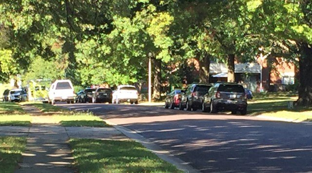 A standoff came to an end about 11:30 a.m. Thursday.Investigators saythey know who they are looking for, andhe is not considered armed and dangerous.(Edwin Watson/KCTV5 News)