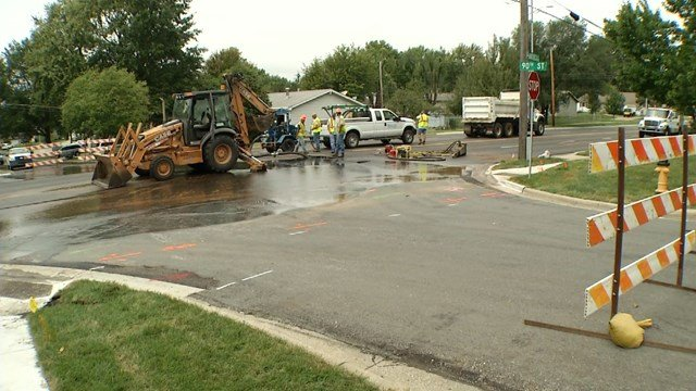 Water covered the road Tuesday and crews have been on the scene every day since trying to ensure the street is safe to drive on. (KCTV5)