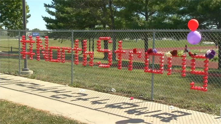 "Students put up a display along the fence to Bronco Stadium that said ""#NorthStrong."" (KCTV)"