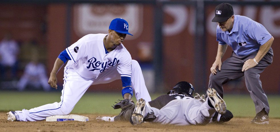 © Kansas City Royals shortstop Alcides Escobar tags out Chicago White Sox's Alexei Ramirez trying to advance to second on a throwing error in the 9th inning. John Sleezer/The Kansas City Star