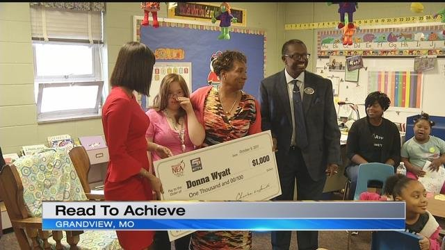 Special education teacher Donna Wyatt received a $1,000 check from the Missouri chapter of the National Education Association. (KCTV5)