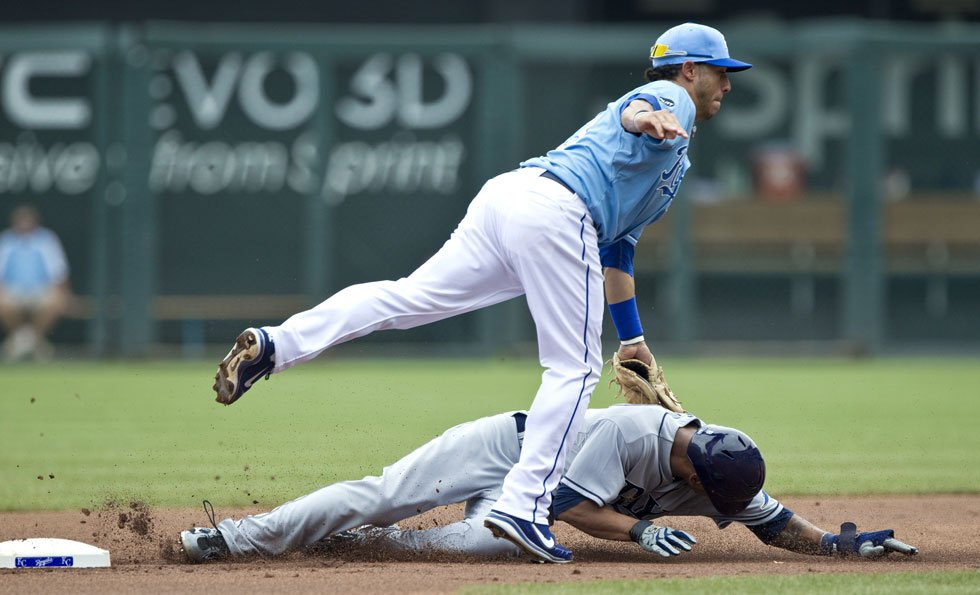 © Tampa Bay Rays' B.J. Upton (2) steals second as Kansas City Royals short stop Mike Aviles (13) tries to tag him in the first inning during Sunday's baseball game at Kauffman Stadium on July 24, 2011, in Kansas City, MO. John Sleezer/The Kansas City Star