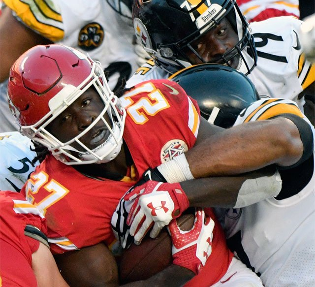 Pittsburgh Steelers players stop Kansas City Chiefs running back Kareem Hunt (27) during the second half of an NFL football game in Kansas City, Mo., Sunday, Oct. 15, 2017. (AP Photo/Ed Zurga)