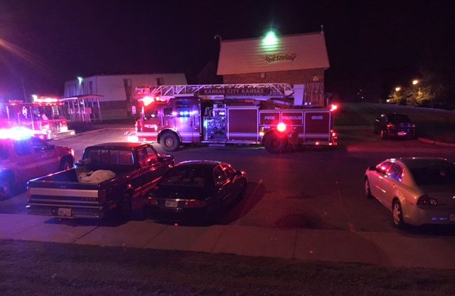 """Witnesses saythey saw a 10-year-old girl running out of the apartments, carrying a toddler and screaming, """"fire."""" (KCTV5)"""