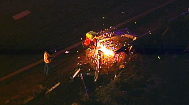 Emergency crews had to cut the guardrail into pieces to get it off the interstate. (KCTV5)
