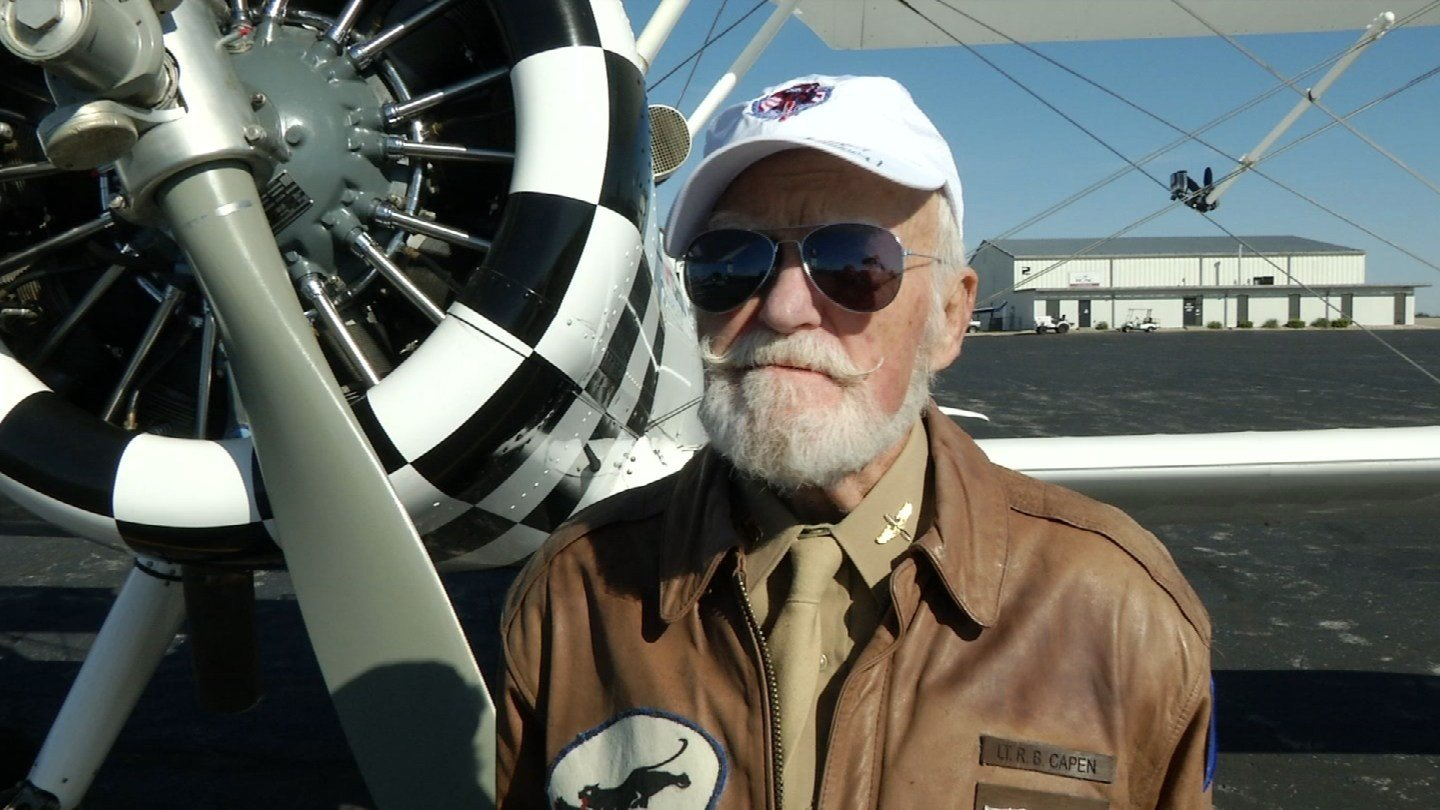 Wearing his old bomber jacket, 92-year-old WWII fighter pilot Robert Capen took off for his flight. (KCTV5)