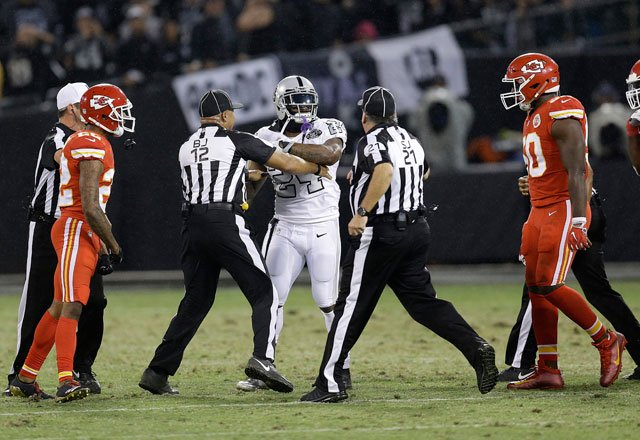 Oakland Raiders running back Marshawn Lynch (24) makes contact with back judge Greg Steed (12) during the first half of an NFL football game between the Raiders and the Kansas City Chiefs in Oakland, Calif., Thursday, Oct. 19, 2017. (AP)