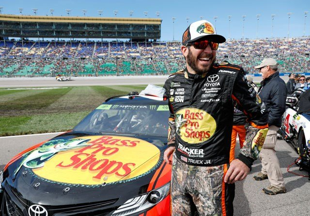Martin Truex Jr. overcame two early mistakes to win a wild playoff elimination race at Kansas Speedway on Sunday, an emotional victory for his Furniture Row Racing team following the death of a crew member the previous night. (AP)