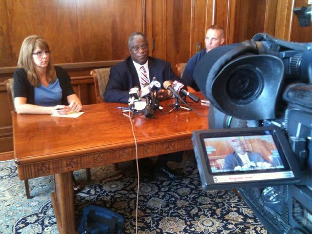 Mayor Pro Tem Cindy Circo, from left to right, Kansas City Mayor Sly James and Kansas City, Mo., police Capt. Steve Young addressed the media during a news conference Sunday.