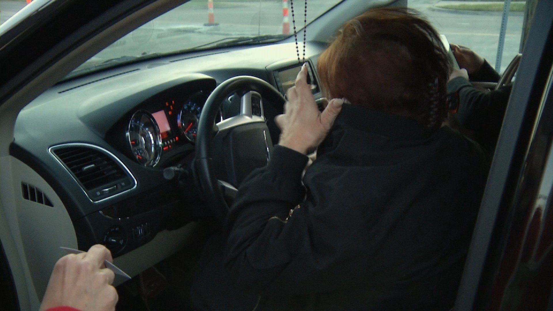 Nancy Marks threw a coat over her face and drove off when our investigative team tried to speak with her outside the shop where she works. We left a business card so she could contact us and offer her side the story. (KCTV5)