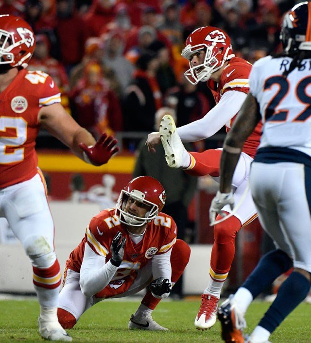 Kansas City Chiefs kicker Harrison Butker, second right, kicks a field goal during the second half of an NFL football game against the Denver Broncos in Kansas City, Mo., Monday, Oct. 30, 2017. (AP Photo/Ed Zurga)