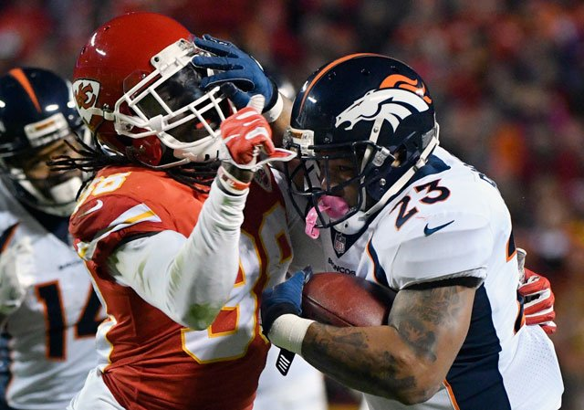 Denver Broncos running back Devontae Booker (23) tries to fend off Kansas City Chiefs defensive back Ron Parker (38) during the second half of an NFL football game in Kansas City, Mo., Monday, Oct. 30, 2017. (AP Photo/Ed Zurga)