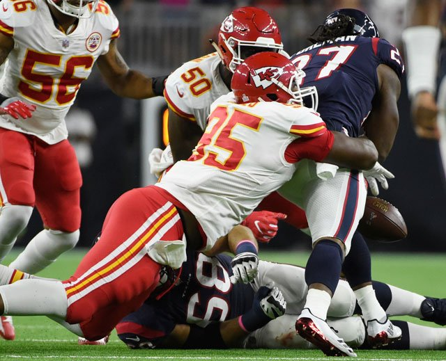 Houston Texans running back D'Onta Foreman (27) fumble as he is hit by Kansas City Chiefs defensive end Chris Jones (95) during an NFL football game, Sunday, Oct. 8, 2017, in Houston. (AP Photo/Eric Christian Smith)