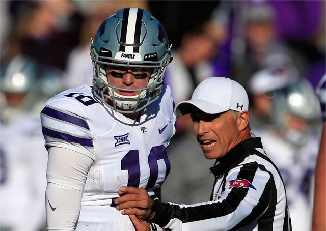 Referee Eddy Shelton, right, talks with Kansas State quarterback Skylar Thompson (10) during the second half of an NCAA college football game in Lawrence, Kan., Saturday, Oct. 28, 2017. Kansas State defeated Kansas 30-20. (AP Photo/Orlin Wagner)