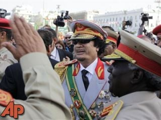 In this Sept. 1, 2009, file photo, Libyan leader Moammar Gadhafi arrives for a military parade in Green Square, Tripoli, Libya. (AP Photo/Ben Curtis, File)