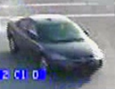 The suspect vehicle is described as a gray 2004-2007 Dodge Stratus sedan. (KCKPD)