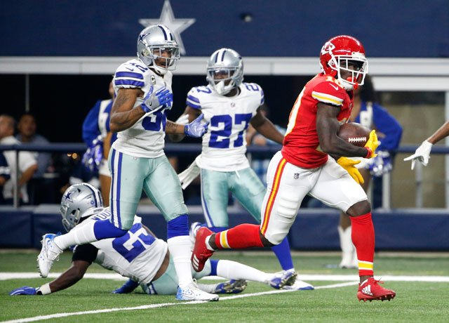 Dallas Cowboys' Xavier Woods (25), Orlando Scandrick (32) and Jourdan Lewis (27) are unable to stop Kansas City Chiefs' Tyreek Hill (10) from reaching the end zone for a touchdown on a long run. (AP Photo/Michael Ainsworth)