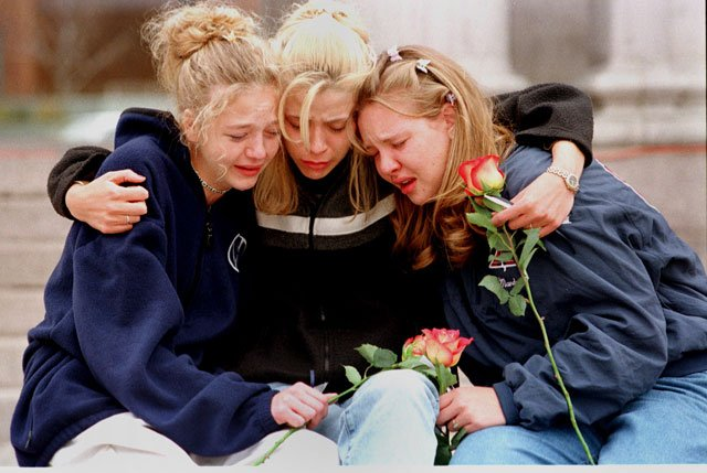 From left, Rachel Ruth, Rhianna Cheek and Mandi Annibel, once sophomores at Heritage High School in Littleton, Colo., console each other during a vigil service to honor the victims of the shooting spree in Columbine High School on April 20, 1999. (AP)