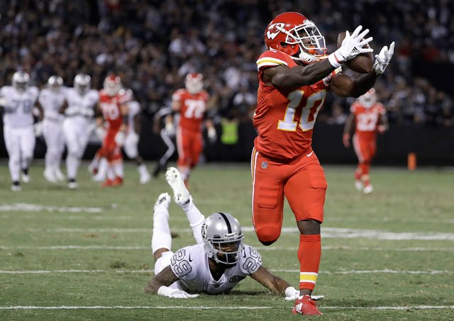 Kansas City Chiefs wide receiver Tyreek Hill (10) catches a touchdown past Oakland Raiders cornerback David Amerson (29) during the first half of an NFL football game in Oakland, Calif., Thursday, Oct. 19, 2017. (AP Photo/Marcio Jose Sanchez)