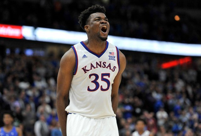 In a game that matched the two winningest Division I programs, the Jayhawks (2-0) prevailed after the two teams spent most of the second half trading baskets and leads. (AP)