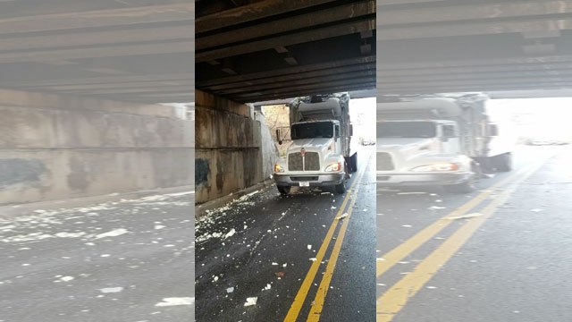 A truck damaged a BNSF Railway bridge on Spruce in Olathe, after the driver failed to heed multiple warning signs about the low clearance. (Olathe PD)
