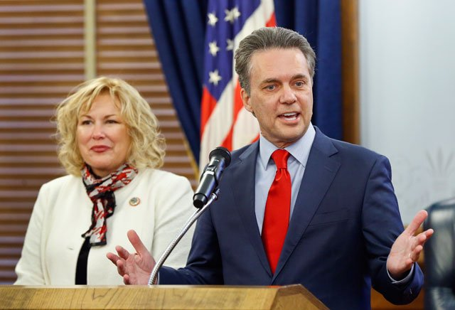 Kansas Lt. Gov. Jeff Colyer, right, announces the appointment of Gina Meier-Hummell to serve as secretary of the Department for Children and Families on Wednesday at the Kansas statehouse. (Chris Neal/The Topeka Capital-Journal via AP)