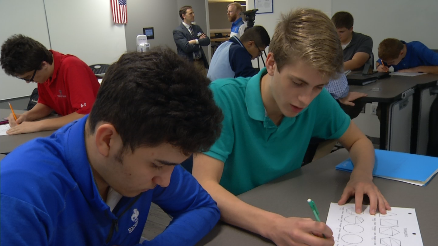 A sophomore geometry class at Rockhurst High School is collaborating to solve a difficult problem with a method that's part of a new learning approach at the school. (KCTV5)